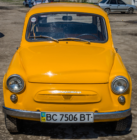 lemberg: LVIV, UKRAINE - APRIL, 2016: Old vintage small car brand Zaporozhets ZAZ yellow on the retro car show Editorial