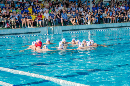 waterpolo: LVIV, UKRAINE - JUNE 2016: Mens water polo team is tuned to the game in the pool shouting their battle cry