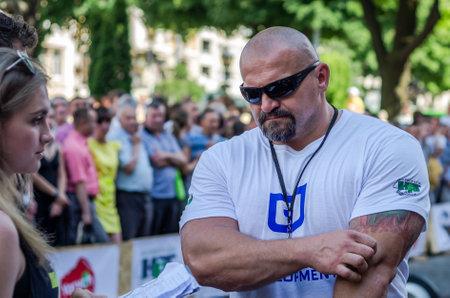 strongest: LVIV, UKRAINE - JUNE 2016: The strongest man in the world - strongman Vasyl Virastjuk