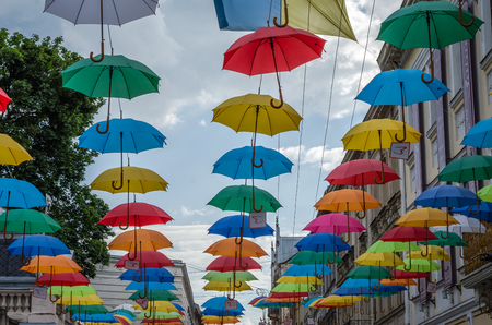 colourful sky: Multi-colored umbrellas hanging in town