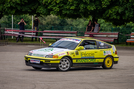 LVIV, UKRAINE - JUNE 2016: Competition in drift racing tuned cars in the Park of Culture in Lviv
