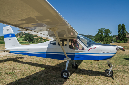 ROMA, ITALY - JULY 2017: A young family (father, mother and daughter) in the cabin of a light aircraft Tecnam P92-S Echo