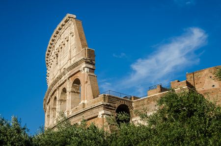 Detail of the wall of the Colosseum in a bright sunny summer day in Rome, Italy