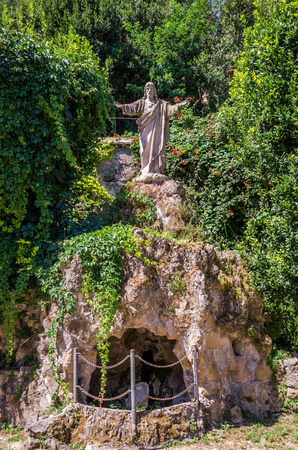 Statues of Jesus Christ in the Courtyard of the Abbazia delle Tre Fontane, in the martyrdom of the apostle Paul in Rome, Italy Stock Photo