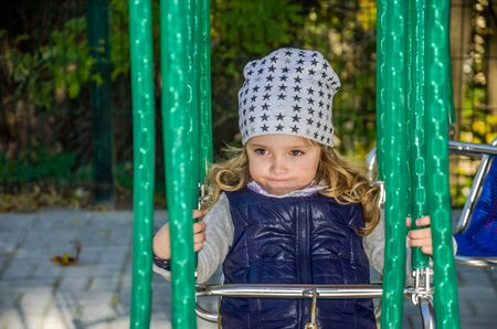 Little girl on a car carpet in an amusement park Stock Photo