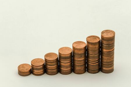 Growing mountain of coins in denomination of two euro cents isolated on white background Stock Photo