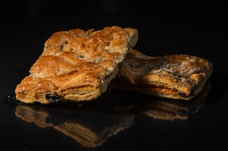 Biscuits with raisins and sugar isolated on black background