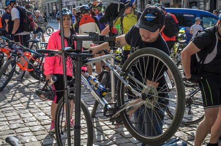 LVIV, UKRAINE - MAY 2018: The cyclist of a punctured wheel