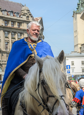 LVIV, UKRAINE - MAY 2018: Knight sitting on a horse in a carnival costume rides in the center of the city on parade