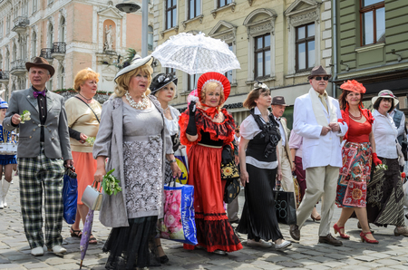 LVIV, UKRAINE - MAY 2018: Artists in carnival costumes are walking in the center of the city on parade