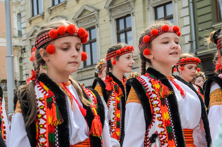 LVIV, UKRAINE - MAY 2018: Children in national costumes at a parade in the city center Editorial
