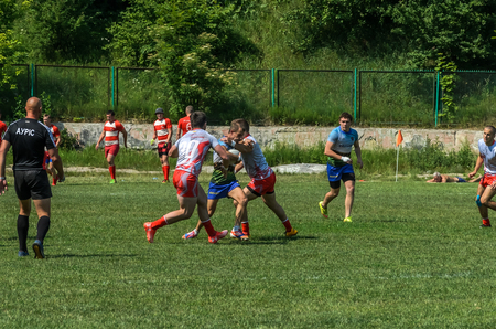LVIV, UKRAINE - JUNE 2018: Athletes play rugby with a ball Editorial
