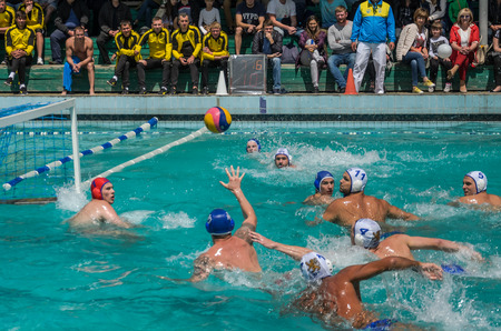 LVIV, UKRAINE - JUNE 2018: Athletes play in the pool in water polo