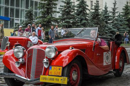 LVIV, UKRAINE - JUNE 2018: Old vintage retro red cabriolet car on city street