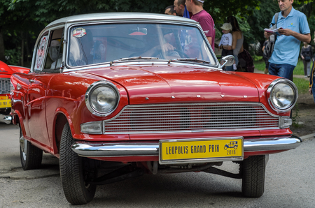 LVIV, UKRAINE - JUNE 2018: Old vintage retro Lloyd car rides through the streets of the city