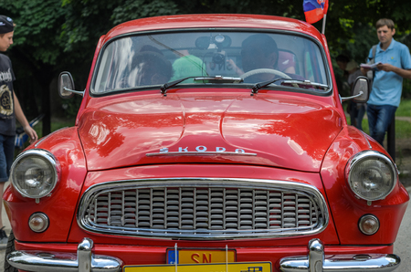LVIV, UKRAINE - JUNE 2018: Old vintage retro Skoda car rides through the streets of the city Éditoriale