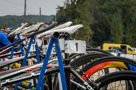 UKRAINE, LVIV - SEPTEMBER 2018: Sports bicycles in the parking area in the transfer area of ??the triathlon competition