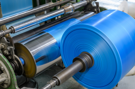 Machine with polyethylene for the production of plastic bags Stock Photo