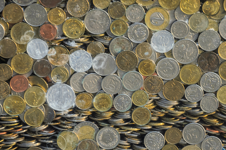 Polish coins zloty and pennies behind the glass