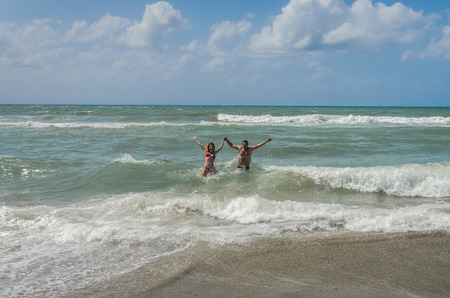 Young couple in love bathes and have fun in the sea