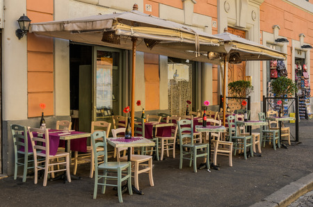 ROMA, ITALY - AUGUST 2018: Terrace of the Italian restaurant in the street Editorial