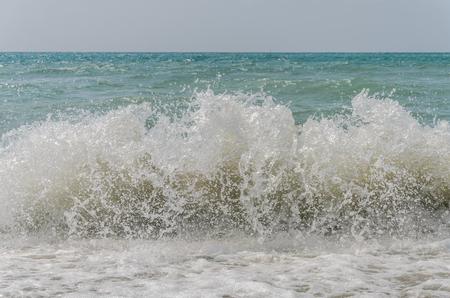 Sea waves on a sandy beach 写真素材