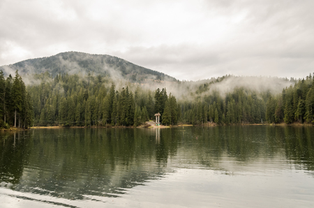 Mountain lake Synevyr in the Carpathians, a rainy day