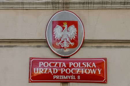 POLAND, PRZEMYSL - OCTOBER 2019: The plate on the house with the coat of arms of Poland and the post office of Poland in Przemysl