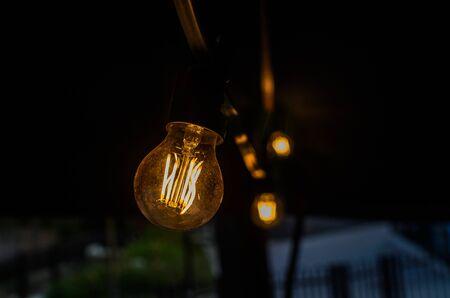 Incandescent light bulb illuminates the dark