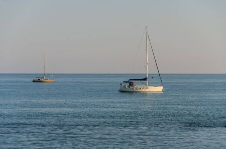 Two sailing yachts at sea