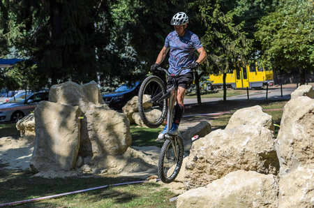 LVIV, UKRAINE - AUGUST 2020: The athlete is engaged in a sports bike trial overcoming obstacles on his bike