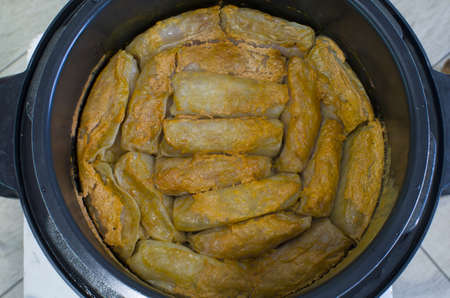 Cabbage rolls with meat are cooked in a saucepan Archivio Fotografico