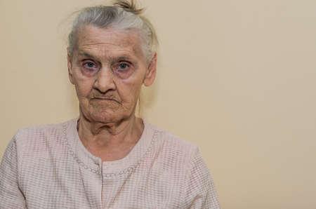 Elderly woman portrait isolated on light background
