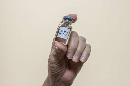 Covid-19 vaccine in the hand of an elderly woman Archivio Fotografico
