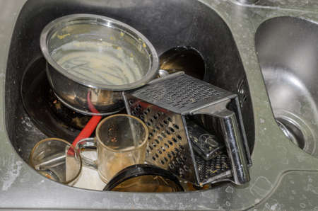 Dirty dishes in the sink in the kitchen