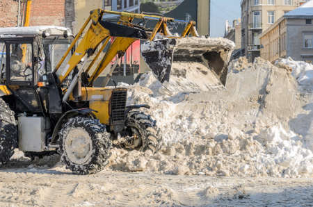 LVIV, UKRAINE - FEBRUARY 2021: Snow removal tractor clears the road from snow Editoriali