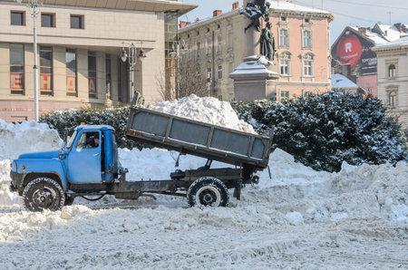 LVIV, UKRAINE - 09 FEBRUARY 2021: Snow removal truck unloads snow
