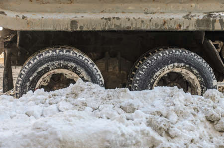 Large wheels of a truck are covered with snow Archivio Fotografico