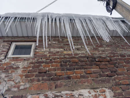 Large icicles on the roof of the building