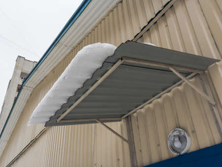 Snow hangs from the roof