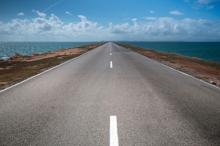 both sides: road stretches into the distance on both sides of the water