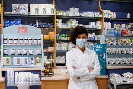 a female pharmacist with mask at work