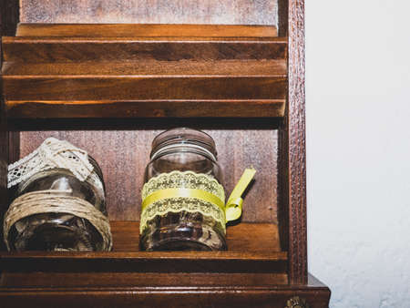 jars decorated with sugar and bottles of oil front view