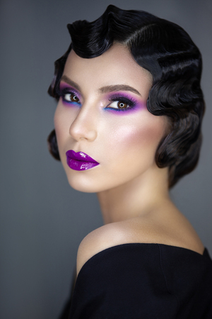 modern beauty portrait of a girl of the 30s in a semi-profile styling hairstyles and makeup Фото со стока