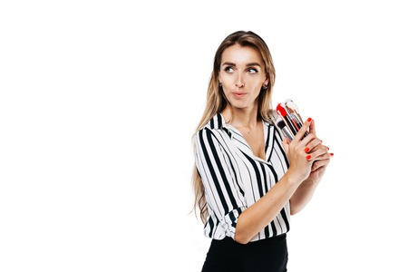 make-up artist girl on a white background holding a white brush and one large red