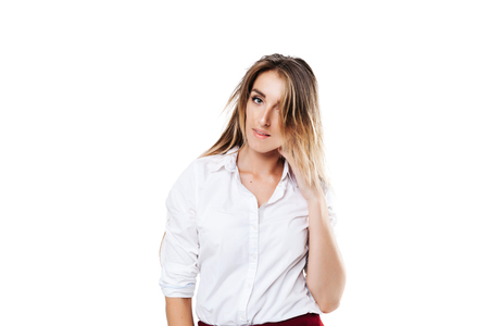girl in a white shirt and burgundy skirt on an isolated white background, with a disheveled hairstyle