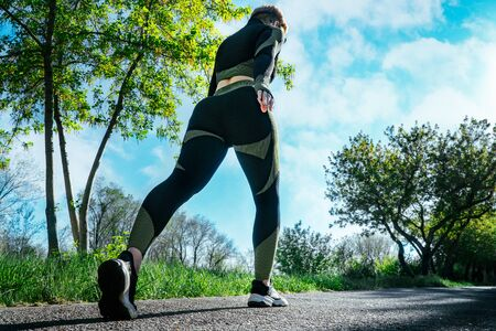 Nice sports woman jogs outdoors.