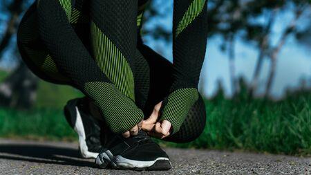 Nice sports woman ties shoelaces 免版税图像