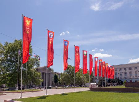 soviet flag: Simferopol, Crimea - May 9, 2016: Flags of the hero-cities (Kerch, Minsk, Brest, Odessa, Smolensk, Tula, Kiev, Stalingrad, Leningrad, Novorossiysk, Sevastopl, Murmansk, Moscow). The central area of Simfiropl Editorial
