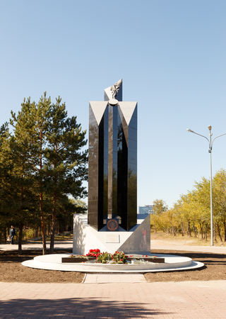 Karaganda, Kazakhstan - September 1, 2016: A monument to the heroes of the liquidators of the Chernobyl accident